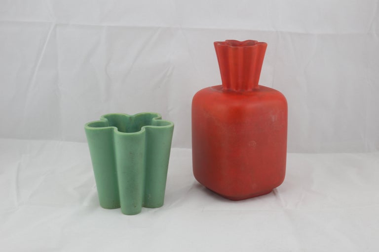 Stunning set of two Italian ceramic vases in mat red and green colors, innovative design and modern look considering the age. Both in good/fair condition, wear consistent with the age and use minor marks. Design by Giovanni Gariboldi in Italy for
