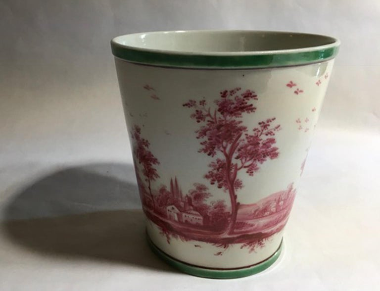 Richard Ginori mid-18th century porcelain cachepot with landscape painting  This is a very nice and delicate piece of antique Italian production of Richard Ginori in Doccia. It's hand painted with landscape in a Flemish style and as a Flemish