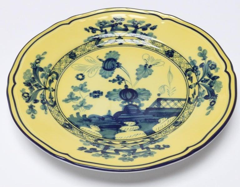 Richard Ginori Oriente Italiano citrino yellow bread plate in the Antico Doccia shape 17cm in diameter.