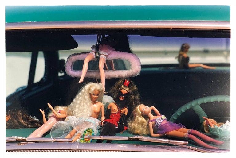 Richard Heeps Portrait Photograph - Oldsmobile & Sinful Barbie's, Las Vegas - Contemporary Color Photography