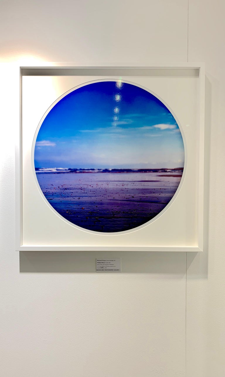 Pebbled Shore, Norfolk - Contemporary, Circle, Waterscape Photography - Blue Color Photograph by Richard Heeps