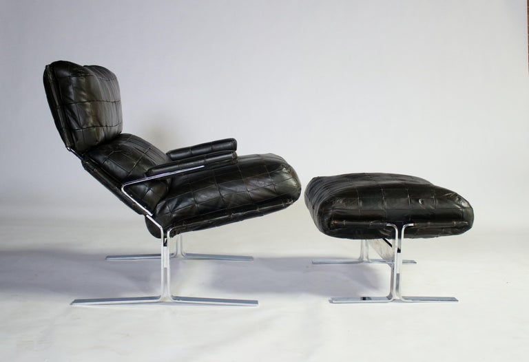 1970s patchwork leather upholstered cushions on polished steel lounge chair and ottoman by Richard Herberger for Saporiti. The steel and leather has been newly polished, and restored and the cushions have been reshaped with new stuffing, all showing
