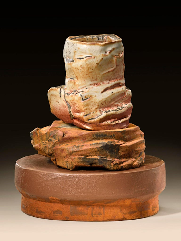 Contemporary American ceramic artist Richard Hirsch's Scholar Rock Cup Sculpture #19 was assembled in 2016. It's wheel thrown and hand built clay, wood fired stoneware with shino glaze, polychrome enamel paint over black glaze and low base red