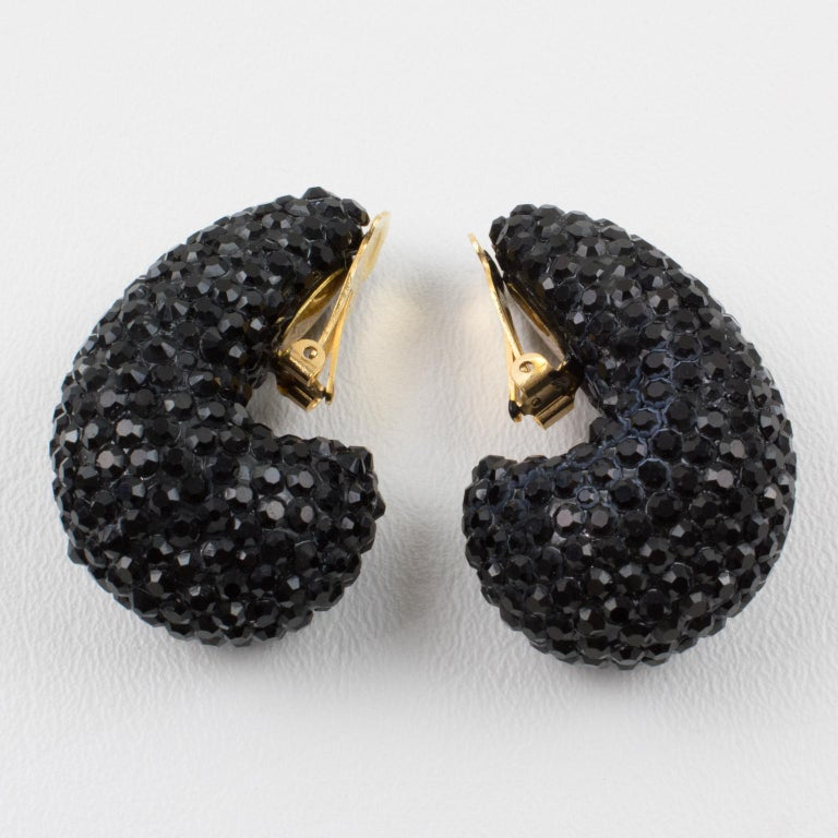 Impressive statement clip-on earrings designed by Richard Kerr in the 1980s. They are made up of his signature pave crystals. Featuring nautilus shape all covered with licorice black color rhinestones. Marked at the back with the designer tag