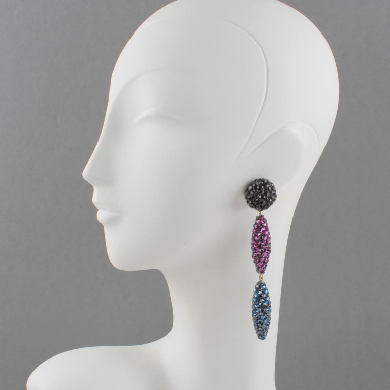 Sophisticated statement clip-on earrings designed by Richard Kerr in the 1980s. They are made up of his signature pave rhinestones. Featuring dangle extra-long drop shape all covered with crystal rhinestones. Assorted colors of licorice black,