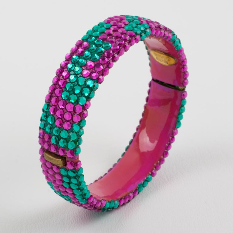 Beautiful statement clamper bracelet designed by Richard Kerr in the 1980s. it is made up of his signature pave rhinestones. Featuring a large band shape all covered with bi-color crystal rhinestones. Assorted bright colors of fuchsia pink and