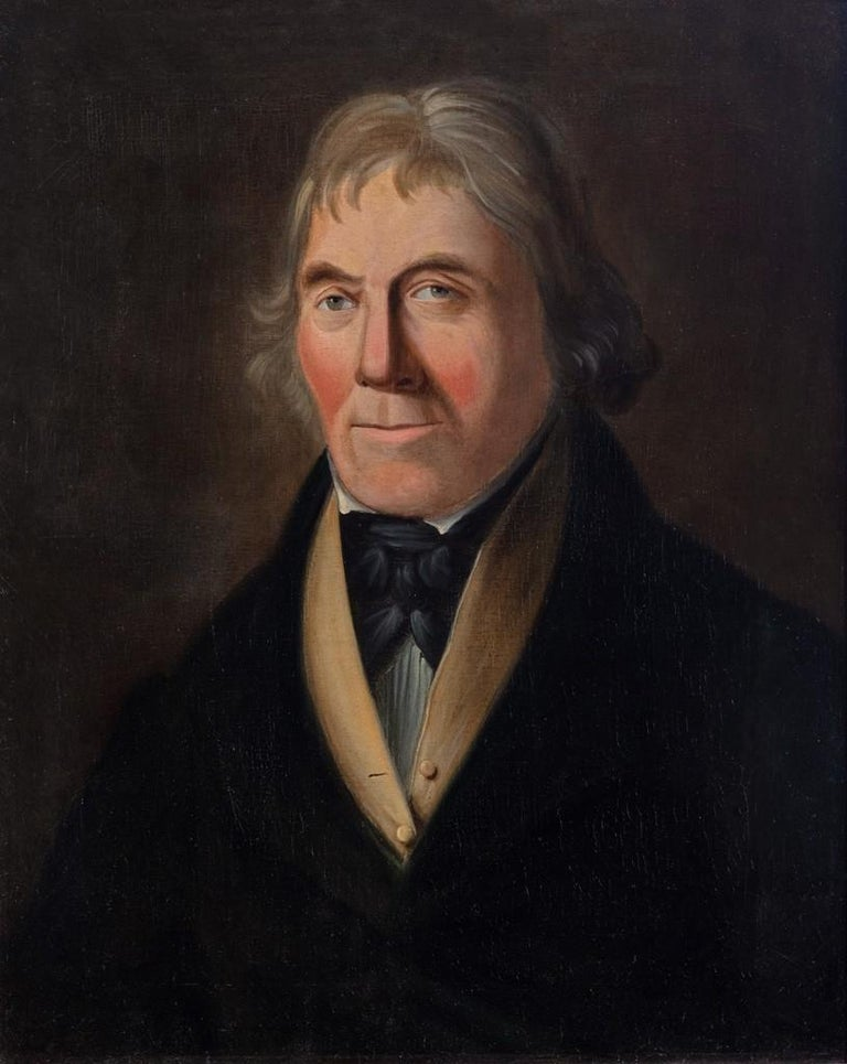This head and shoulders portrait shows a man with a black cravat and top coat with a buttoned camel colored waistcoat and white shirt below, oil on canvas, inscribed on the back 'Robert [sic] Nicholson of Blyth , Chief Carpenter, aboard H.M.S.