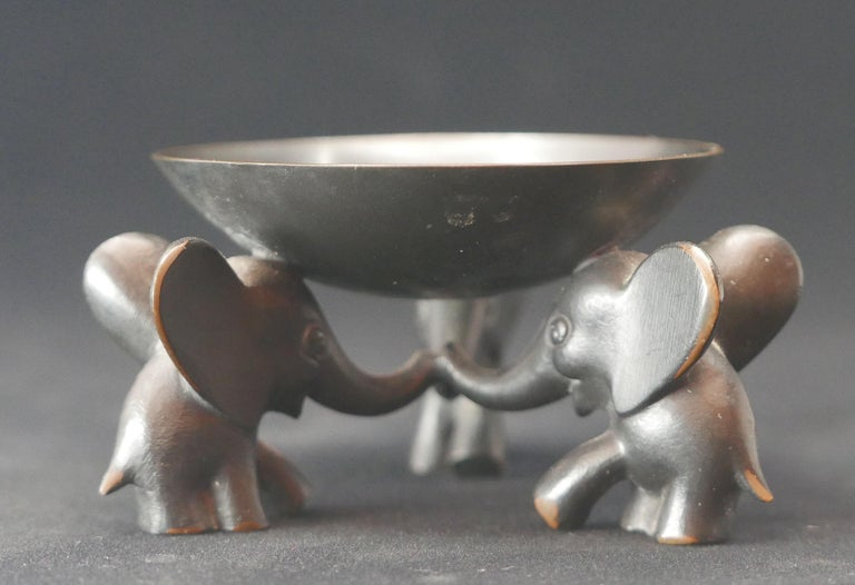 Stunning small pedestal bowl with three elephants supporting the bowl, made from blackened brass. Designed and executed by Richard Rohac in Austria in the 1950s, who worked also for WHW Hagenauer Vienna. Probably originally designed as an ashtray