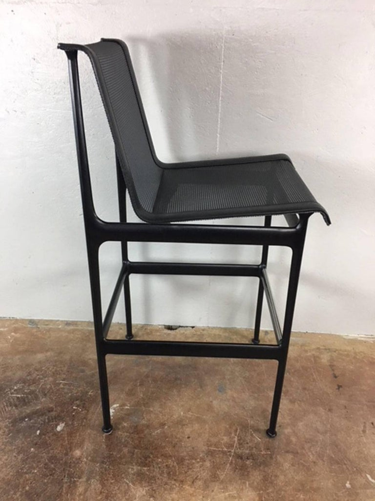 Sold in pairs, these original Richard Schultz bar stools are in exceptional condition. Barely used, these tightly woven black nylon sling style chairs were stored for most of their life. High quality. No rips, holes, tears, or unusual wear.