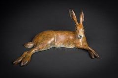 'Lying Hare' Solid Bronze Wildlife Sculpture with Brown Patina. Limited Edition.