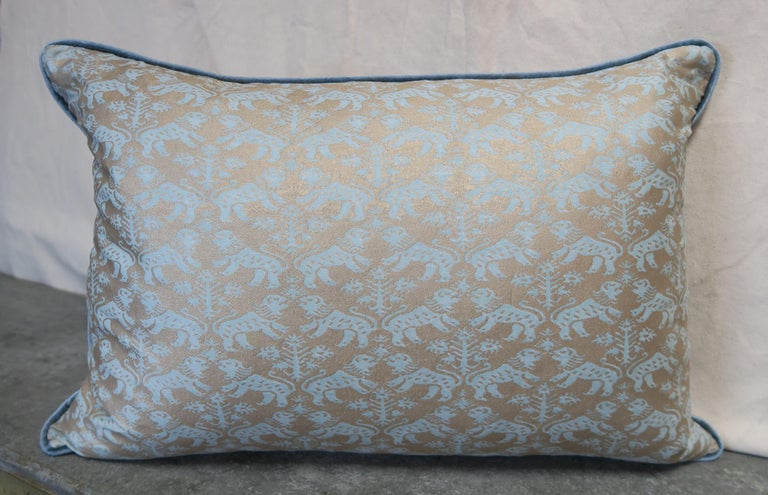 A pair of custom Richelieu patterned Egyptian cotton Fortuny textile pillows in aquamarine and silvery gold. Blue velvet backs and self cording. Down inserts, sewn closed.