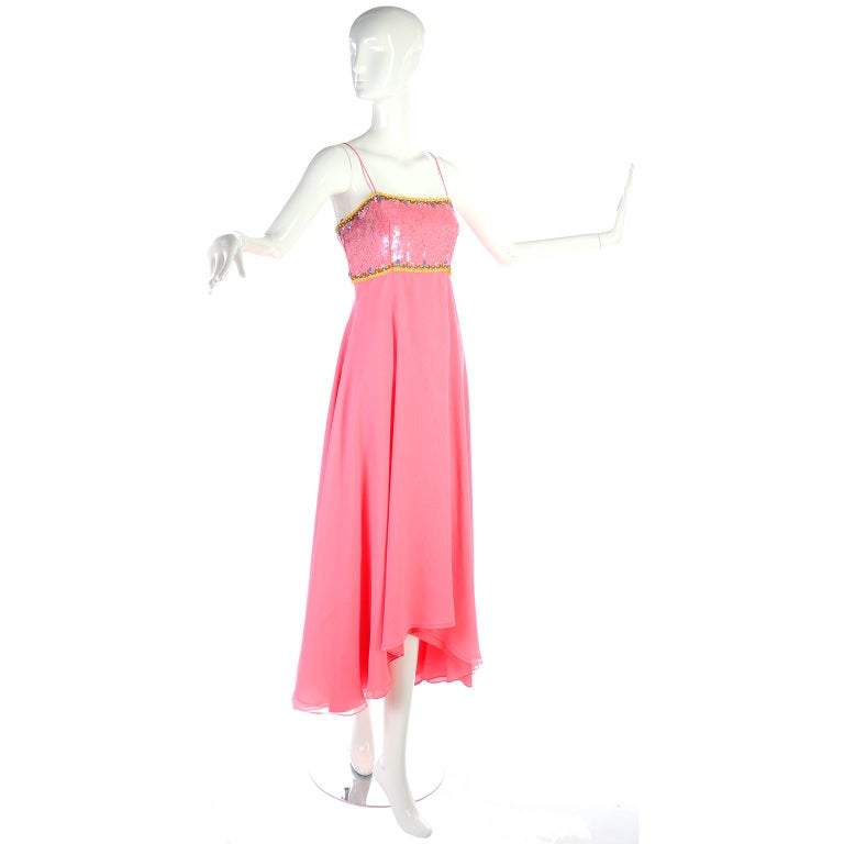 This is a lovely vintage dress from Richilene with long double layers of pink chiffon with an asymmetrical hem that comes with a beautiful jacket with beads and sequins.. The late 1970's or early 1980's evening gown has spaghetti straps and a