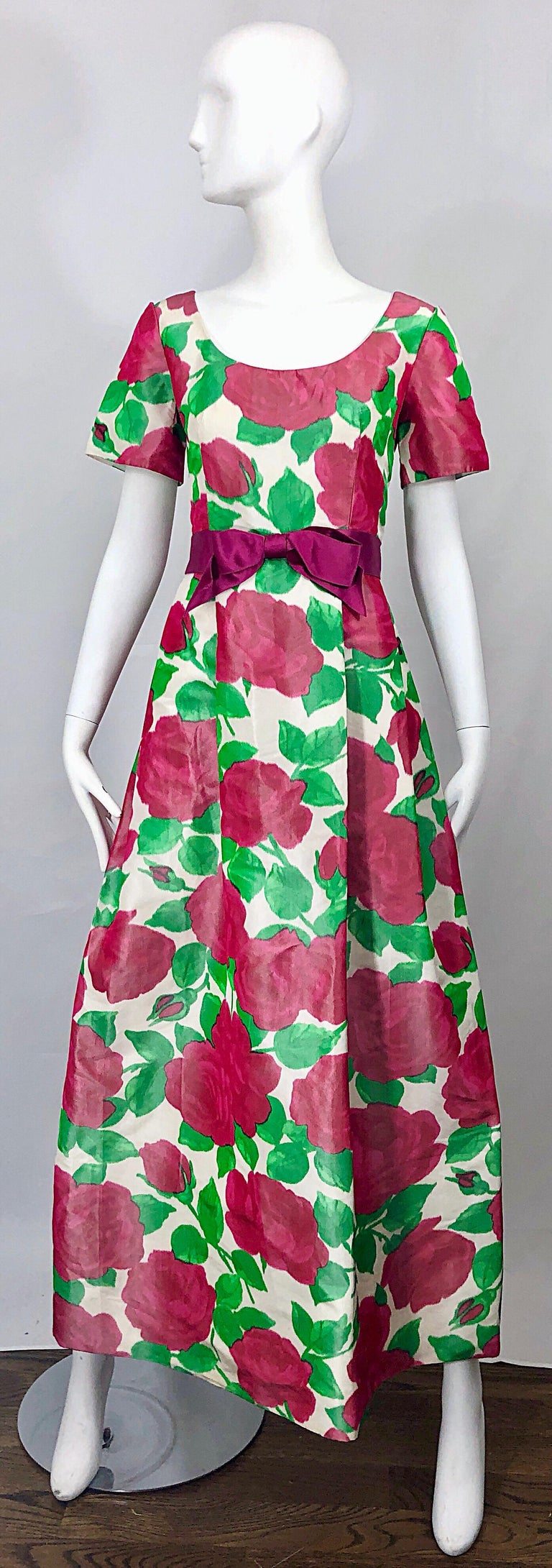 Beautiful vintage RICHILENE for ELIZABETH ARDEN silk taffeta 3-D rose print short sleeve couture gown! Features bold rose prints in vibrant hot pink and green. 1960s / 60s style, with a tailored bodice with a forgiving full bell skirt. Fuchsia silk