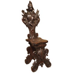 Richly Carved 19th Century Escabelle Chair from Switzerland