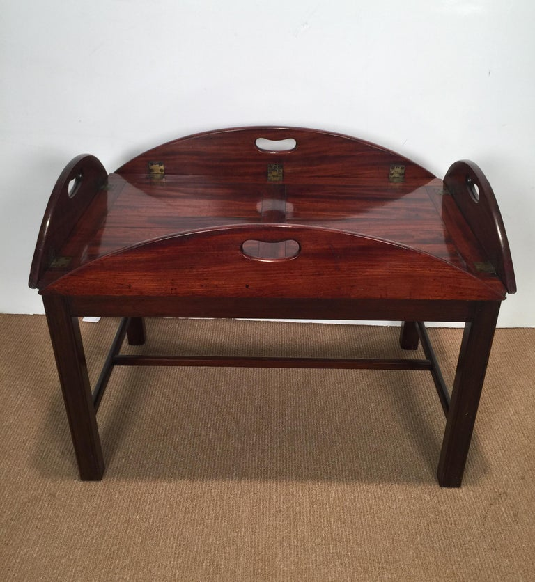 Richly figured mahogany warm patina antique butlers tray on a later base The tray is circa 1840 and the base is 1900s, very nice table.