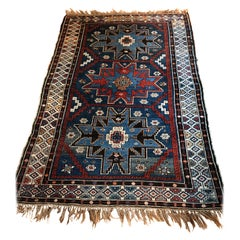 Richly Patterned Antique Area Rug in Blues and Cranberry