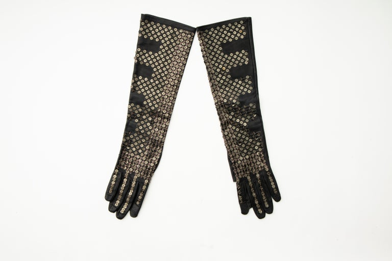 Rick Owens, Fall 2015 Runway black/dark dust leather gloves with fingerless thumb and index finger and stitched sequins embellishments throughout.   Size: 7  Length: 17.5