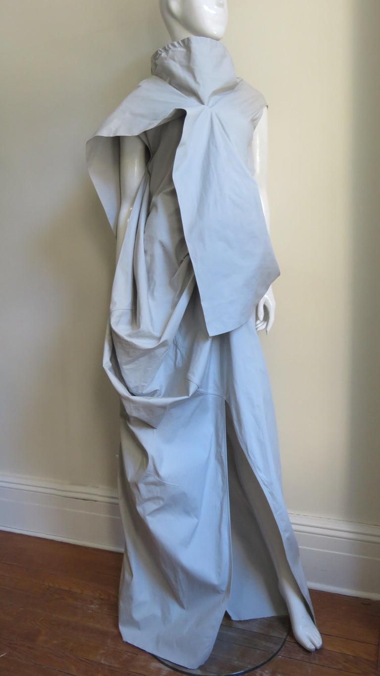 A fabulous pale taupe cotton with a bit of stretch maxi dress from avant garde master Rick Owens.  It is sleeveless with an adjustable stand up collar, a flap across the front and back bodice, draping at one side, and front and back slits in the