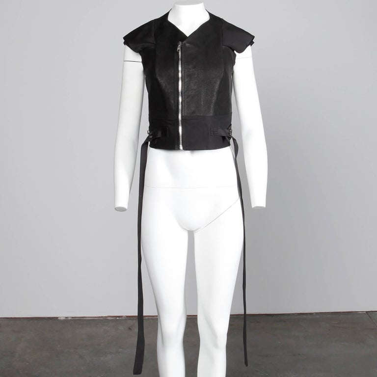 Unworn with the original tags still attached from S/S 2015! Rick Owens leather jacket or vest with unique sleeves and asymmetric zipper. Fully lined with front zip closure. 100% calf leather, 97% cotton, 3% spandex. The marked size is I 44/ GB 12/