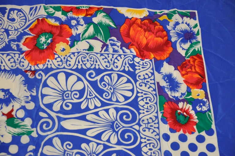 Rickie Freeman for Teri Jon wonderfully huge bold and vivid lapis blue & white accented with multi color  florals silk scarf measures 41 inches by 42 inches. Small stain but hardly noticeable near one border. Made in Italy.