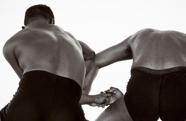 Dancing Men 3. Black and White Archival pigment print, Medium - Contemporary Photograph by Ricky Cohete
