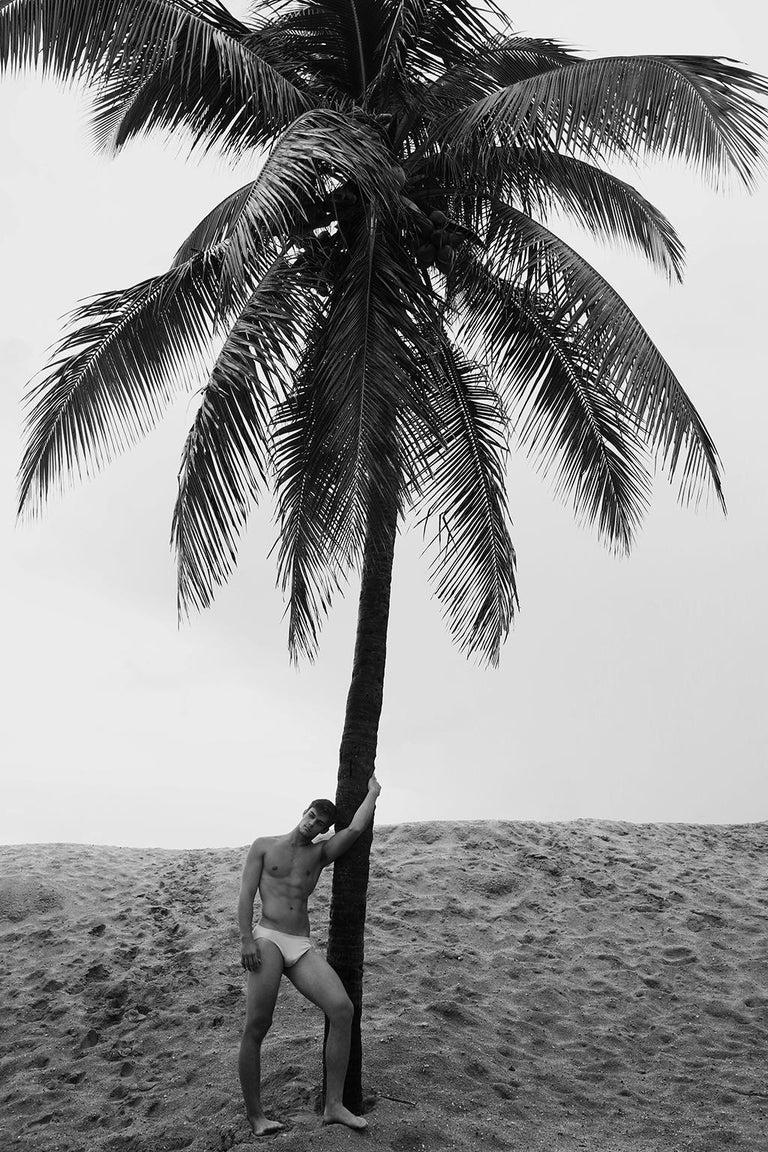 Ricky Cohete Black and White Photograph - Men and Palm Tree. Black & White Archival pigment print,  Medium