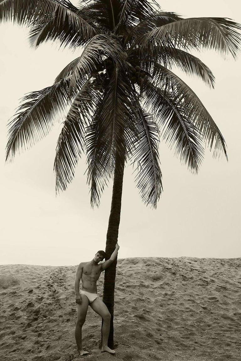 Ricky Cohete Color Photograph - Men & Palm Tree. Sepia Archival pigment print, Medium