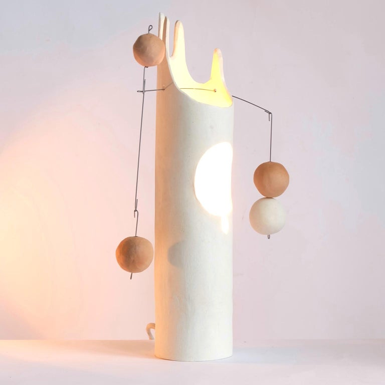 Mico's Cousin Rico is a contemporary hand-built sculptural ceramic table lamp that inspires the joy of working with hands through unpacking, assembling and balancing weights. The handmade ceramic globes and the hanging steel wire come fit right