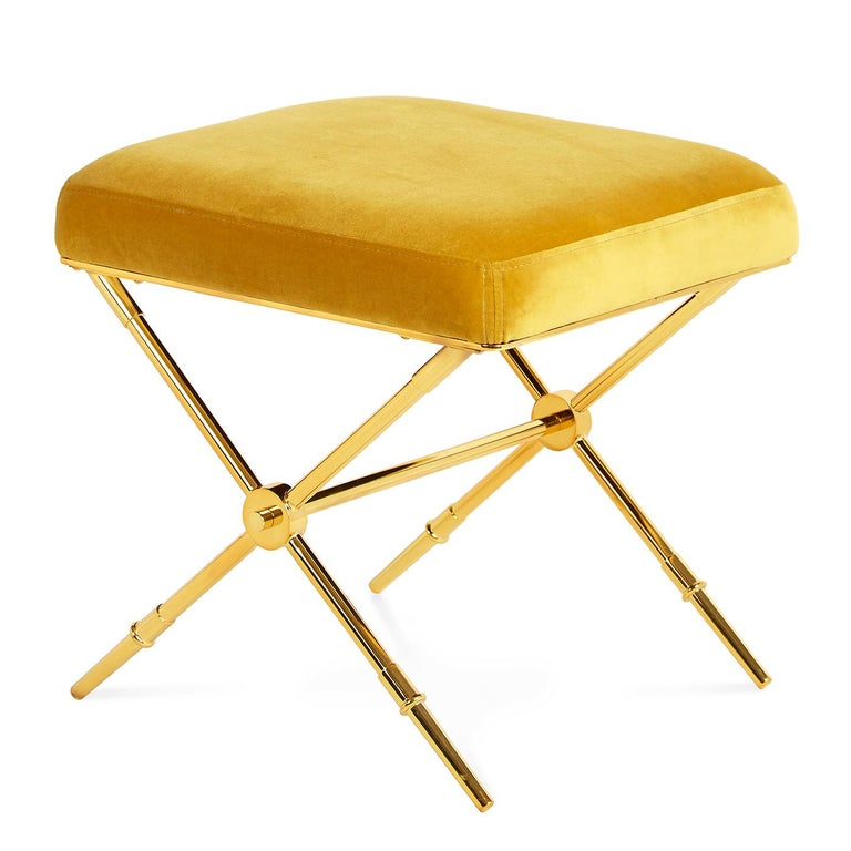 Golden glow. Our updated take on Empire style, the Rider Bench doubles as a tiny table when topped with a tray. An embroidered plush velvet seat on sabot-detailed legs. Gleaming brass with golden velvet upholstery—luxe and surreal all at once. Fab