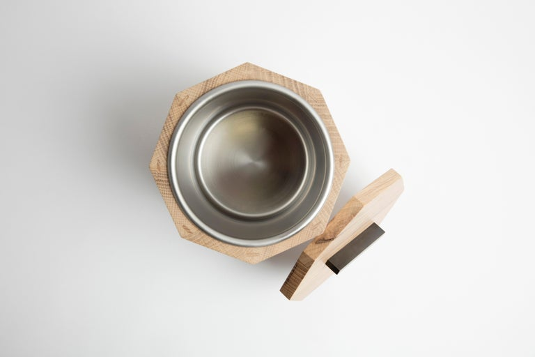 Our solid wood ice bucket is hand-crafted with solid white oak from Birmingham's urban forest. Modern geometric barware strikes a clean line on your counter. Store ice for cocktails or keep a bottle of your favorite white wine cool and crisp for