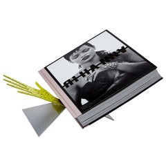 The Rihanna Book: Limited Edition (Fenty x Phaidon) featuring a designer stand
