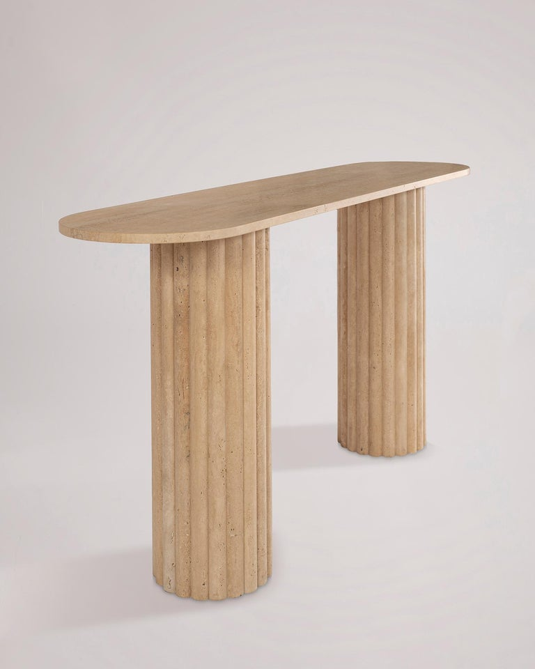 In the RIMA console by the Jalisco, Mexico–based studio Peca, classic and traditional lines are paired with the strength and elegance of marble. Combining the cadence of the turned rod texture base and the luscious feel of the surface created by the