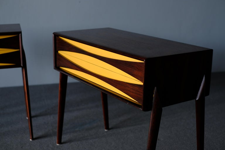 Beautiful and elegant pair of nightstands in rosewood, designed by Rimbert Sandholt and produced by Glas & Tra Hovmantorp the 1960s. The design is subtly detailed and modest in expression. It features drawer pulls in a distinctive organic shape