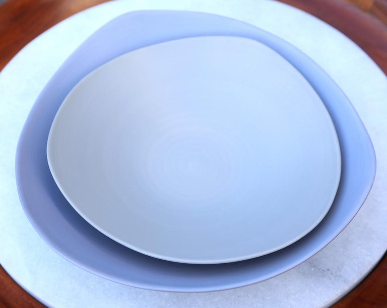 Triangular handmade ceramic soup plate in lavender and bowl in grey.  Measures: Plate lavender $175 (diameter 9.75