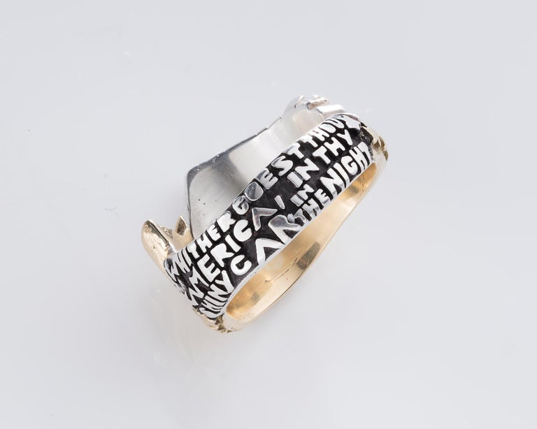 Untitled ring in sterling silver, 18-karat gold, rubies, and sapphires. Includes the following text carved on the verso of the ring band: