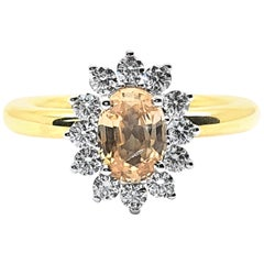 Ring with 1.03 Carat Pink Sapphire with Diamonds in 18 Carat Yellow Gold