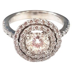 Ring with Central Diamond and Double Halo