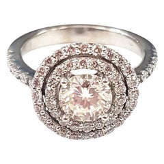 Ring with Central Diamond and Double Halo in 18 Karat Gold