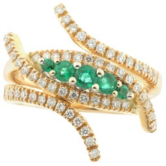 Ring with White Diamonds and Emeralds in 18 Karat Rose Gold