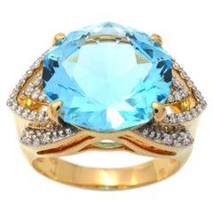Ring Yellow Gold Blue Topaz 9.40 Carat and Diamonds