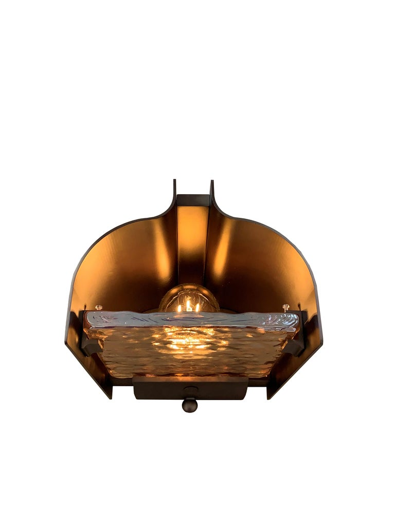 Other plugs are available by request.  Description: Ripple glass bedside table lamp Color: Bronze Size: 23 x 17 x 34H cm Material: Bronze and glass Collection: Ripple Plug: UK Plug Voltage: 220