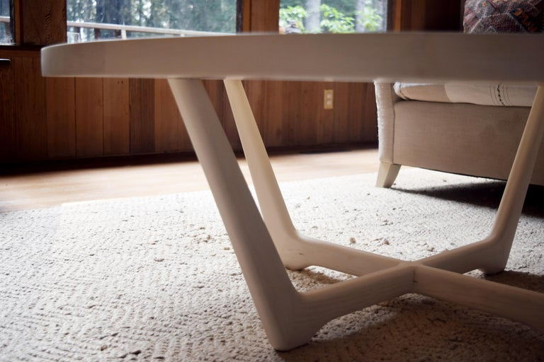 American Rise Modern Coffee Table in Bleached Maple with Sculpted Base For Sale