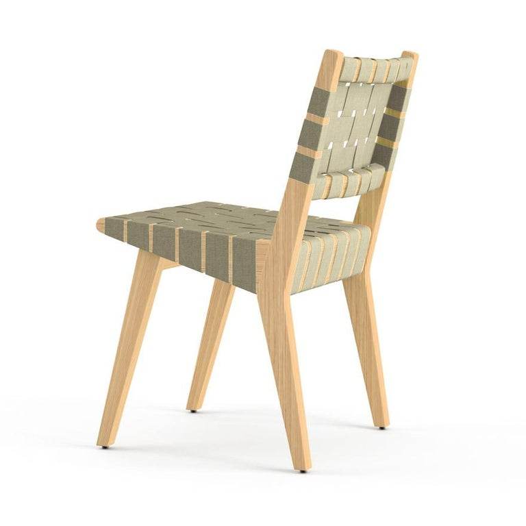 Jens Risom's designs were the first pieces conceived for and manufactured by Knoll. Due to wartime material restrictions, the lounge chair was originally constructed of simple maple frames and discarded parachute webbing. Described as good, honest