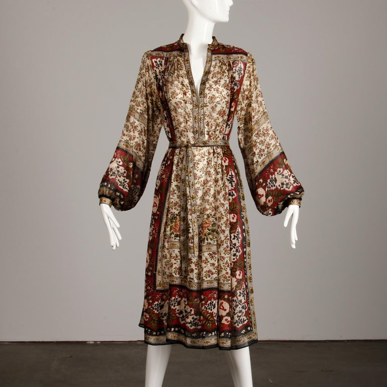 Absolutely stunning Ritu Kumar for Judith Ann 1970s vintage Indian hand block printed 100% silk dress and sash. Unlined with front hook closure at neckline, button and snap closure at the wrists. The marked size is medium, but the dress should also