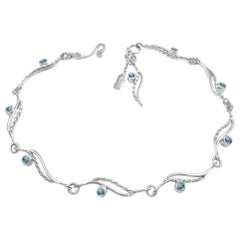 River-Rose Twist Flow Bracelet with Teal Sapphire 18 Karat