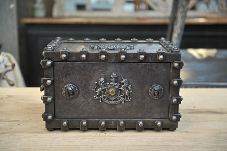 Iron safe box cabinet with big rivets by Bauche (FRANCE) with original key, original inside fabric, circa 1900. Weight 14 kg.