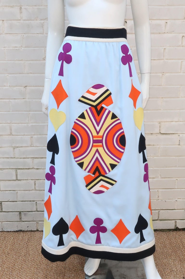 It's game night and Egyptian designer, Youssef Rizkallah, for Malcolm Starr has fashioned an attention getting maxi skirt in a pale blue wool blend fabric with colorful playing card felt appliques just for the occasion.  The black and white