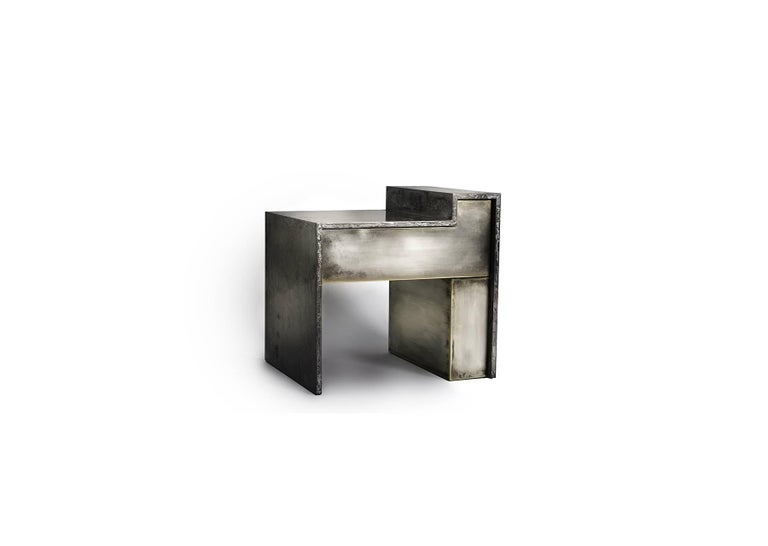 The bespoke RLB BST bedside table is a nightstand that can be produced in a variety of brass and liquid metal based finishes. As pictured, these tables feature hand silvered brass façades with a liquid gun metal finished structure. A single drawer
