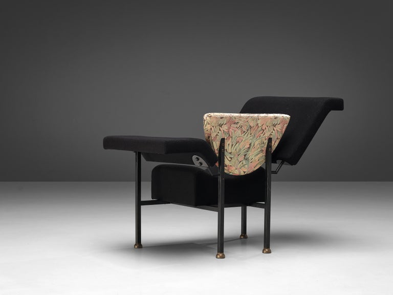 """Rob Eckhardt for Pastoe, lounge chair model """"Groeten Uit Holland"""", metal, brass, black and floral-patterned original upholstery, the Netherlands, 1983  This versatile lounge chair by Dutch designer Rob Eckhardt can be used in two different ways."""