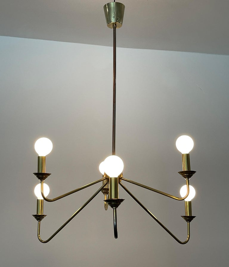 Brass chandelier, Robert Caillat, circa 1955. Brass chandelier from a set of ten with six-light. Fully rewired to be used in US. Candelabra sockets with brass hardware. We got ten similar chandeliers from this hotel, different colors and degrees